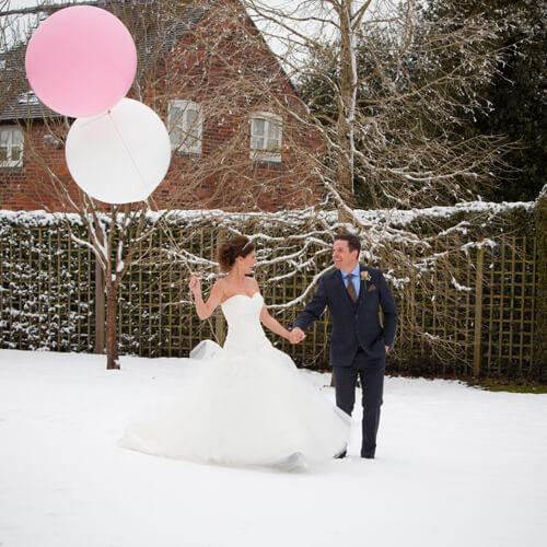 in snow with balloons